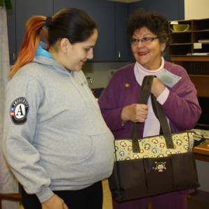 Veronica giving bag to a client